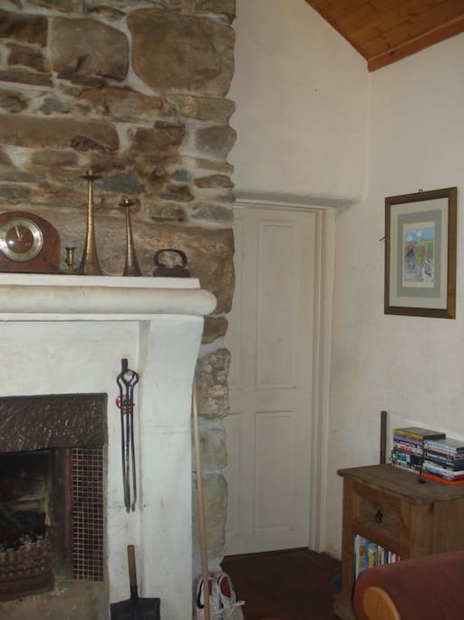 Cosy turf fire at the heart of the farmhouse.