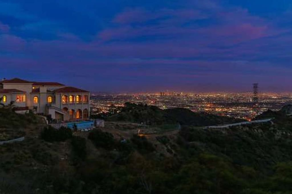The estate has 270 degree views of the entire LA basin including the Hollywood sign, downtown LA and the coastline out to Catalina Island