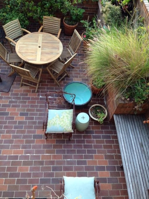 Private outdoor courtyard with seating for 6