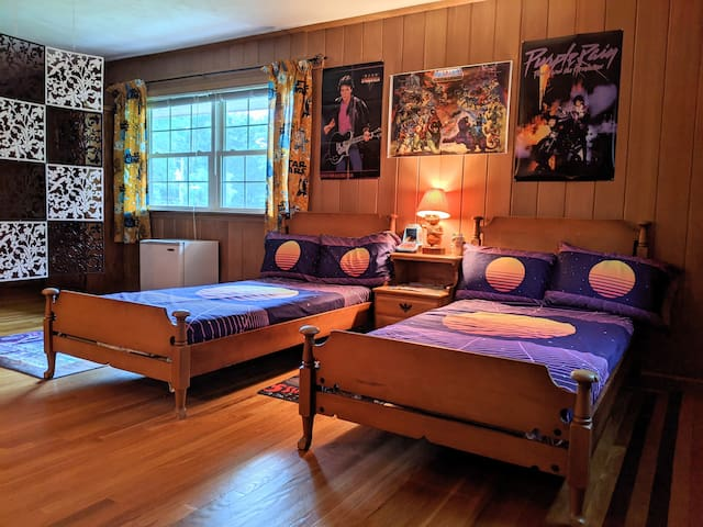 Your totally rad 80's themed bedroom features two comfortable twin beds, a mini-fridge, a 1986 Magnavox stereo with plenty of 80's vinyl to spin plus every game console that ever existed from the beginning to CD platforms!