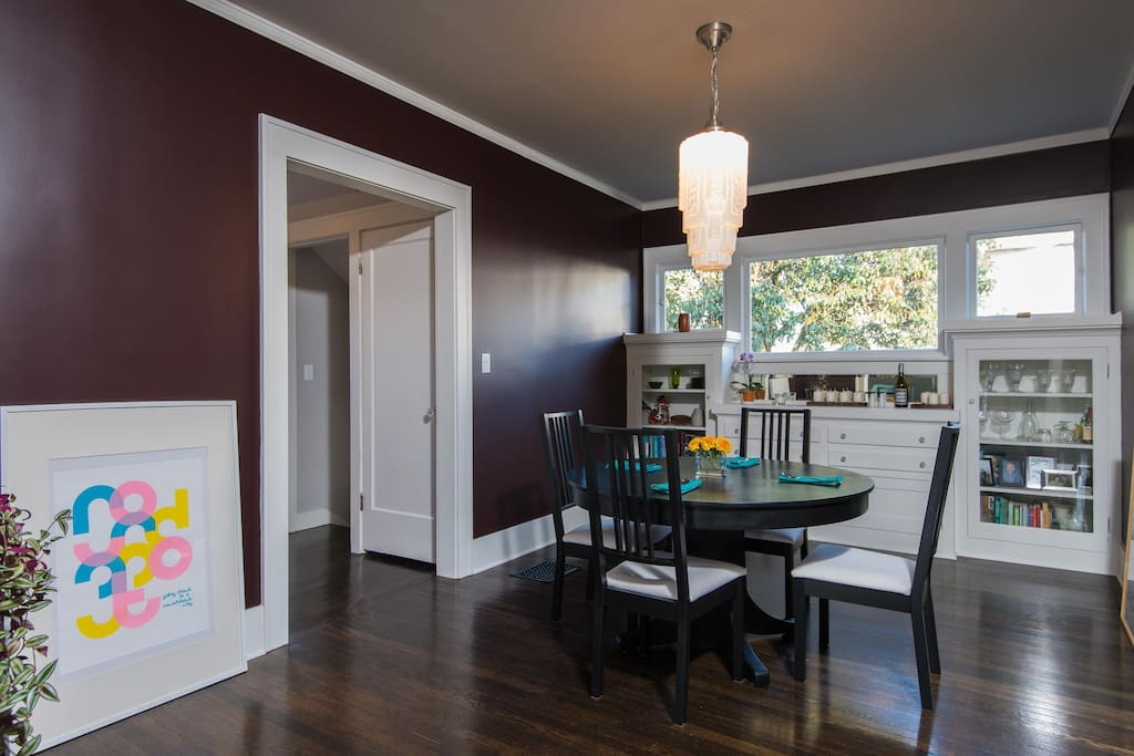 A separate dining room with vintage built ins