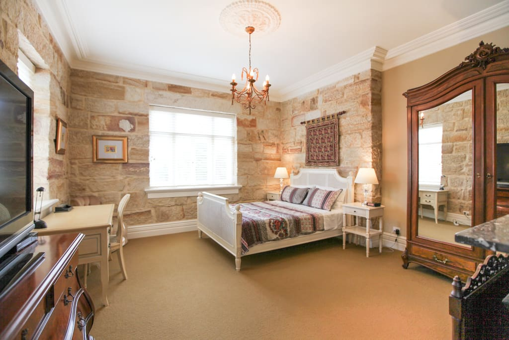 Extra spacious bedroom with period furniture & large TV