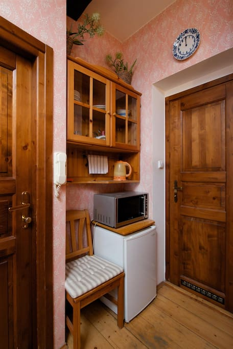 """""""Kitchen"""" corner with microwave, mini fridge, electric kettle and utensils"""