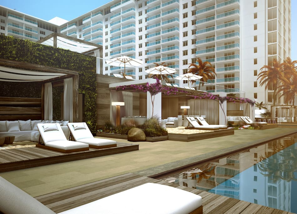 Poolside cabanas face the beach