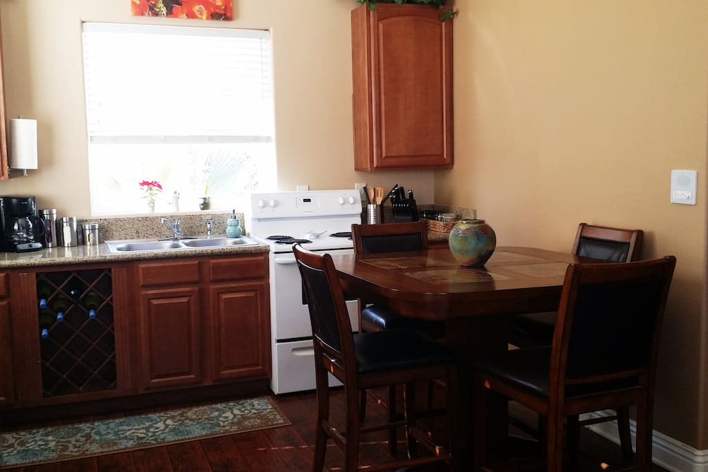 Full kitchen and dining area.