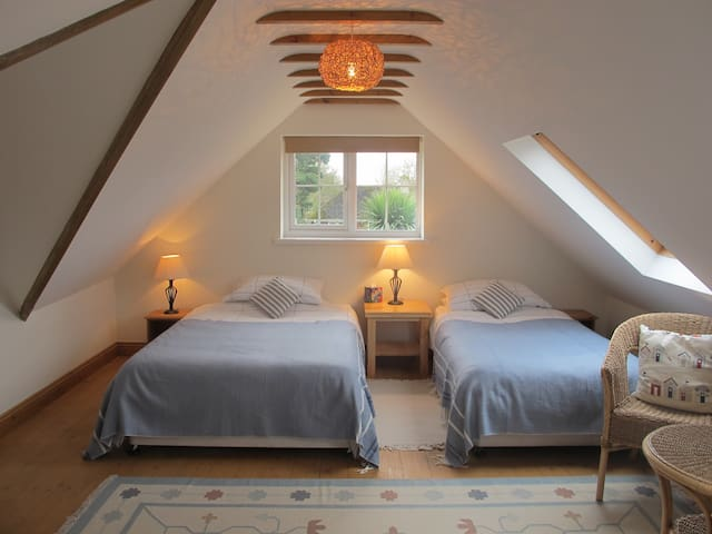 Spacious bedroom with sloping ceilings