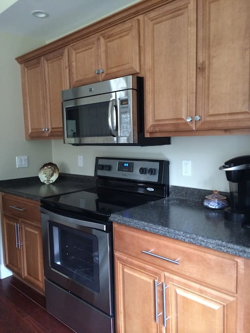 Convection microwave, full size oven, Keurig coffee maker, lots of counter tops.