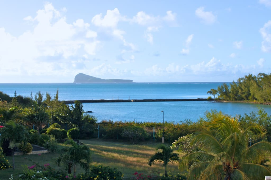 Picture taken from the second floor balcony - To my personal point of view: Coin de Mire, the island on the horizon,  one of the most stunning scenic view of Mauritius. Waking up to this every morning is a bliss! Huge garden with a superb banyan tree and a renovated tennis court.