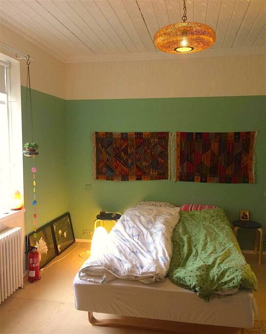 Large bedroom with a double bed on the quiet garden side