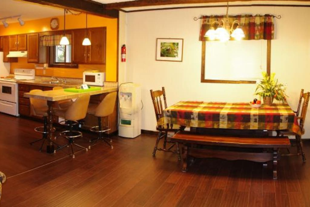 Bar-style dining kitchen peninsula and large rustic table are available for  your family gatherings.