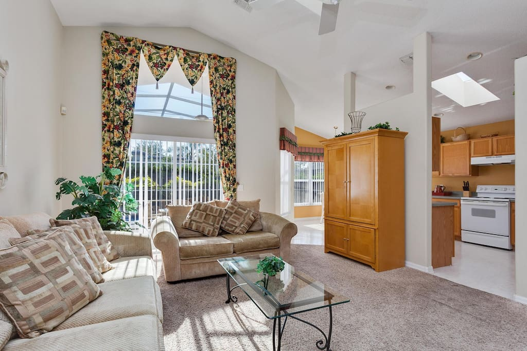Bermuda Bliss has a spacious family room to relax in during the day or evening, with ceiling fans, comfortable sofas, an entertainment center with cable TV.