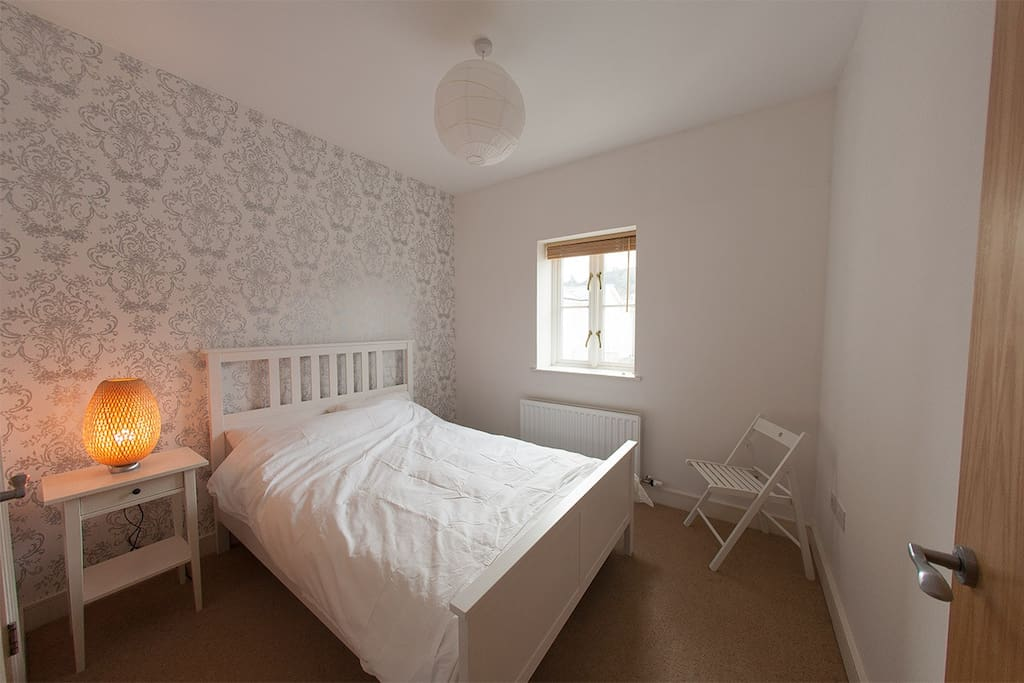 The main bedroom with adjoining ensuite bathroom