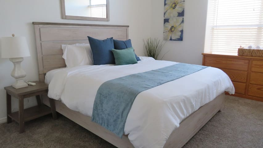 Upstairs master bedroom with king bed, walk in closet and en suite private bathroom