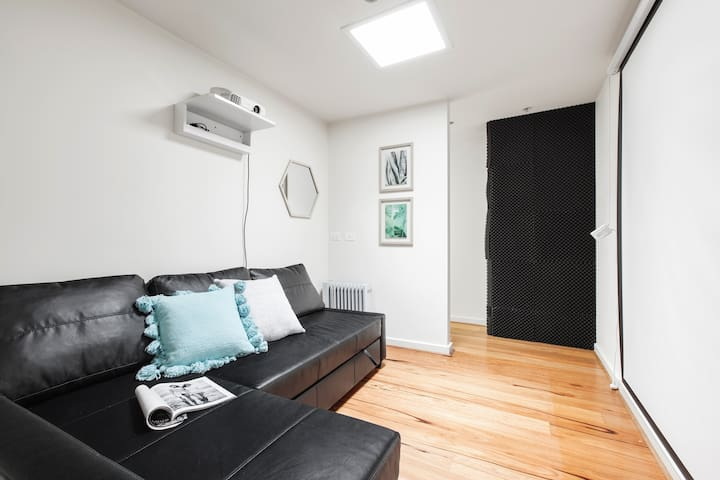 Cinema room with large projector screen. Sofa folds out into a super comfortable double bed! All linen/pillows supplied.