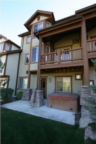 Back side of townhome, private hot tub off lower level.  Deck off family room w/ grill