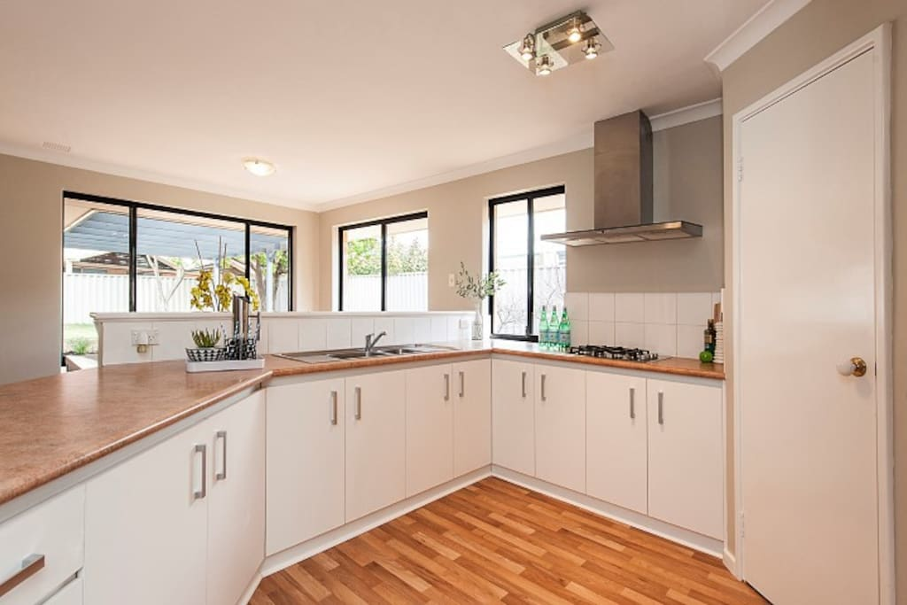 Modern fully equipped kitchen with oven, gas cooktop, full sized fridge/freezer, microwave and pod coffee machine.