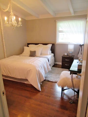 Guest bedroom.  Original hardwood floors and wood beam ceilings throughout.  This vintage dream home stole my heart back in 2005 the moment my realtor and I walked in.  I love my home and truly enjoy being there.  I hope you will too.