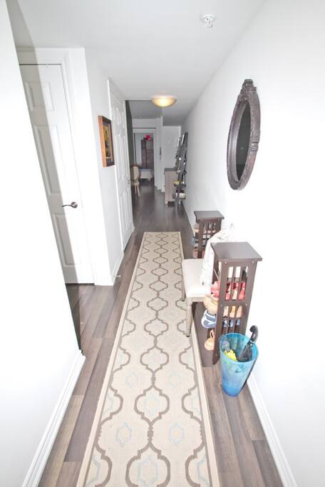 Welcome to my lovely 2 bedroom, 2 full bathroom unit - with this long hallway separating the bedrooms to ensure quiet sleeps from your fellow travelers