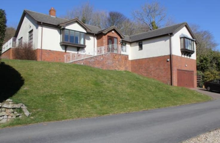 Semi-rural bungalow with extensive views.