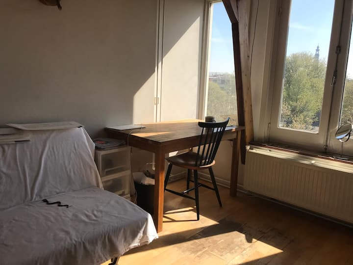 Sunny room with Amsterdam canal view