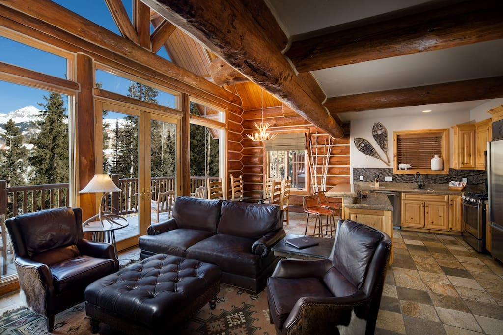 Cabin living room showing kitchen.