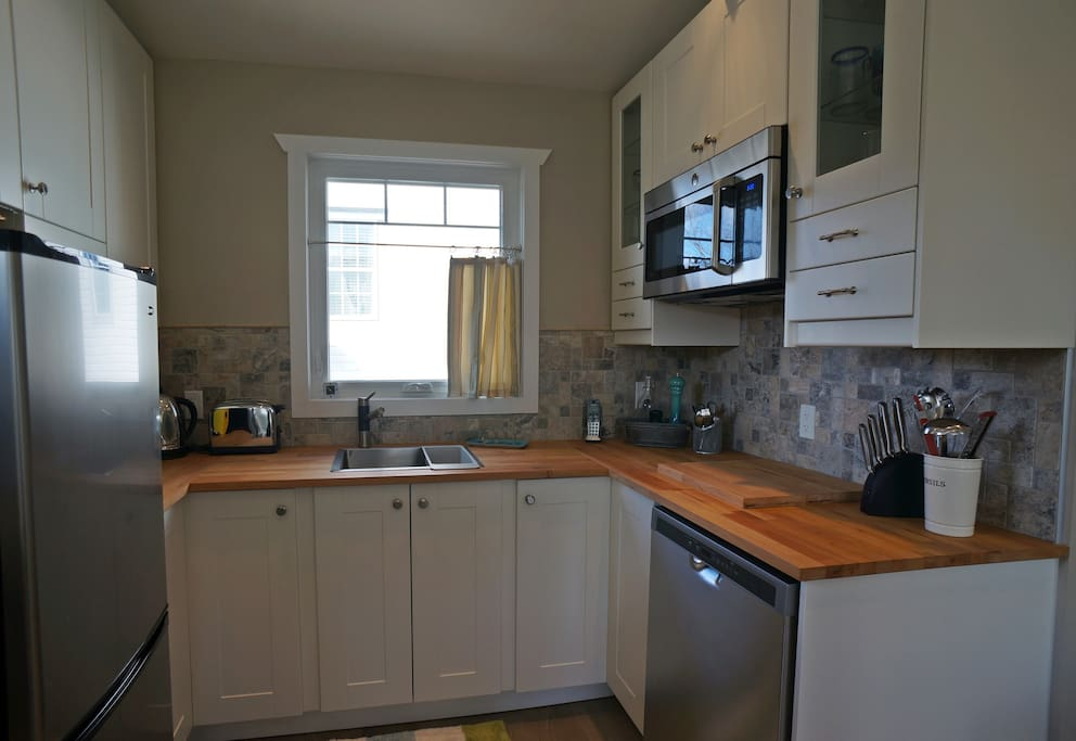 Pantry - Ample storage, fridge/freezer, D/W & Convection Microwave. No full stove - alternate options available