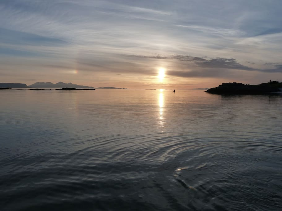 View from the beach towards the Islands of Rum and Eigg in the evening.