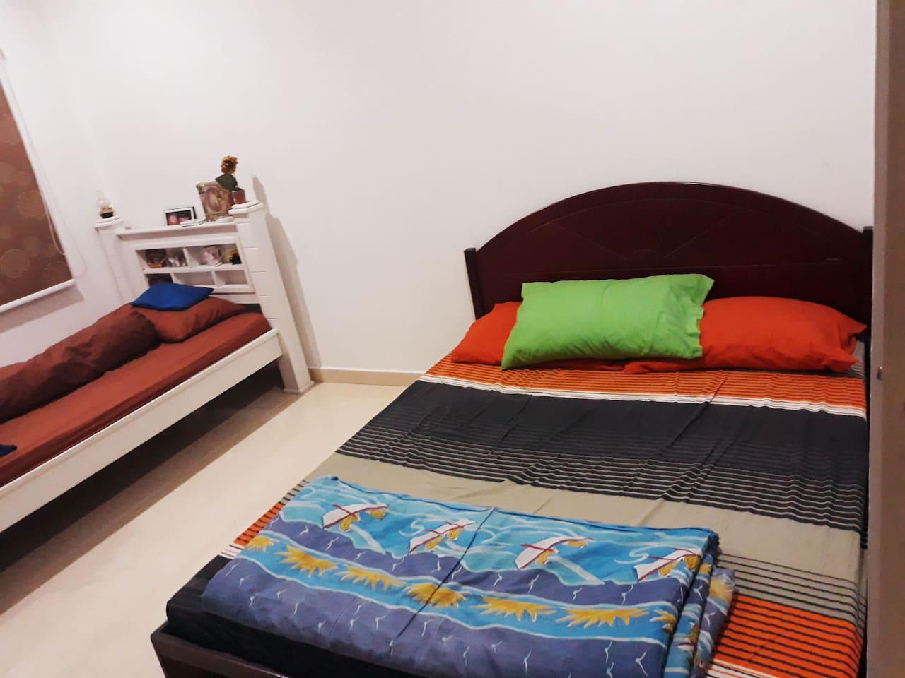 tidy spacious room with 1double+1super single bed..