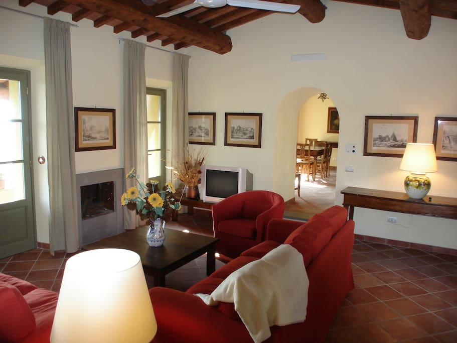 Your living room with door to porch to relax and view Tuscany campania
