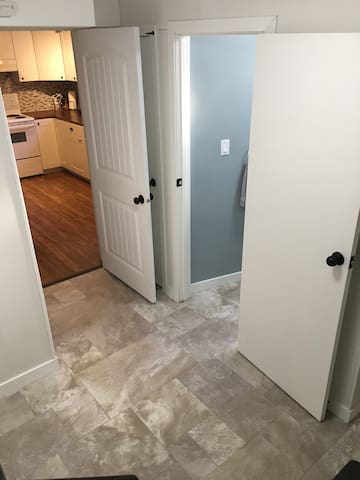 Entry area. Access into kitchen and half bathroom.
