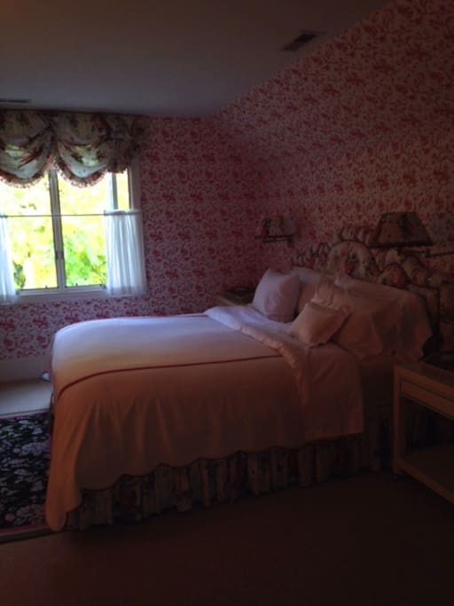 King bed with comforter and hand pressed linens