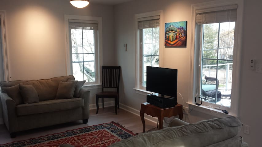Cozy living room with cable TV and two pullout sleeper love seats