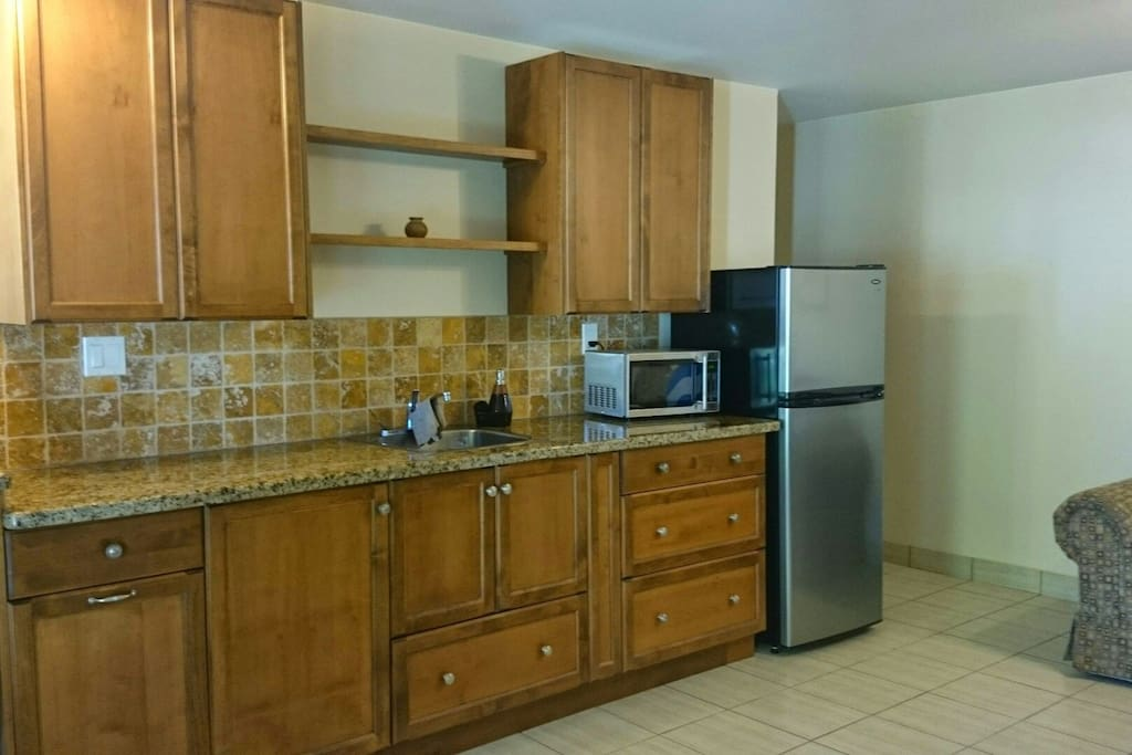 Fully equipped kitchen with hotplates, microwave, grill, wine glasses, pots and pans, plates etc.
