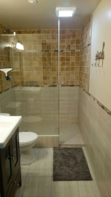 Walk in shower with infloor heating throughout the whole suite.