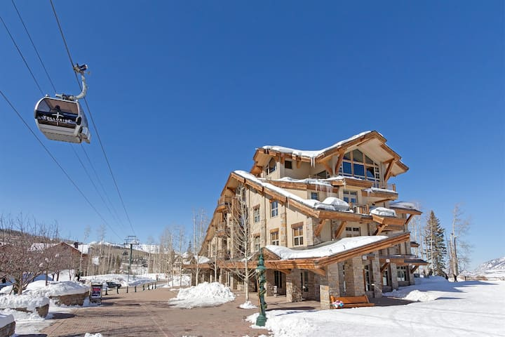 Enjoy Live Music from the Deck of this Charming Ski Chalet with Ski-In Ski-Out Access and Stunning Views