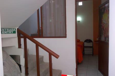 Sun Island Hostel - Isabela - Casa