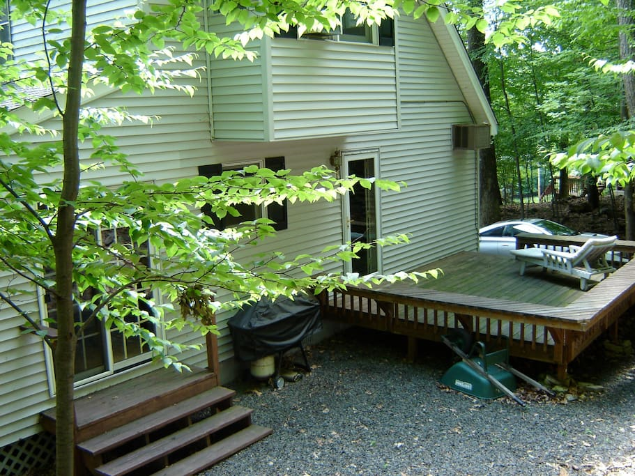 Your vacation home from the back, deck and grill