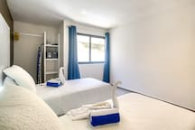 Two twin beds, security box, iron, hair dyer, air conditioning