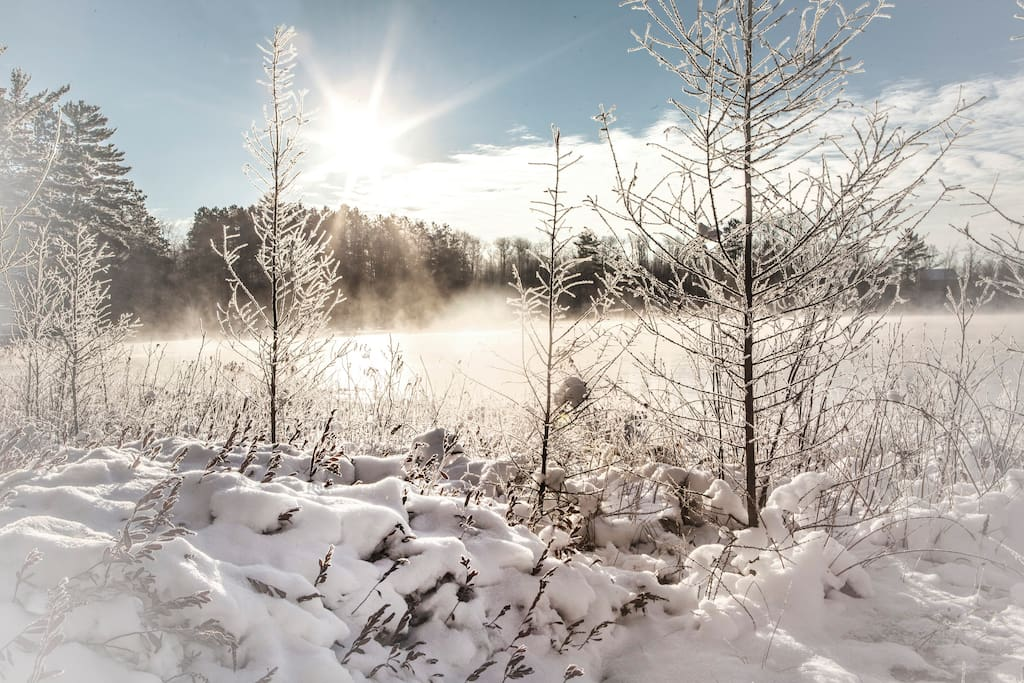 Sun peaking out over a frozen over Heiress Lake.