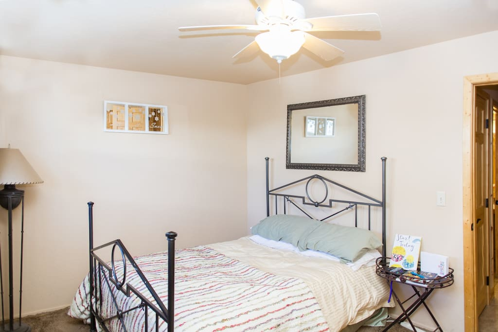 Feather bed and pillows, the iron bed frame is gone thanks to guest feedback who said it gives them more room to walk around the bed. There is no headboard at the current time.