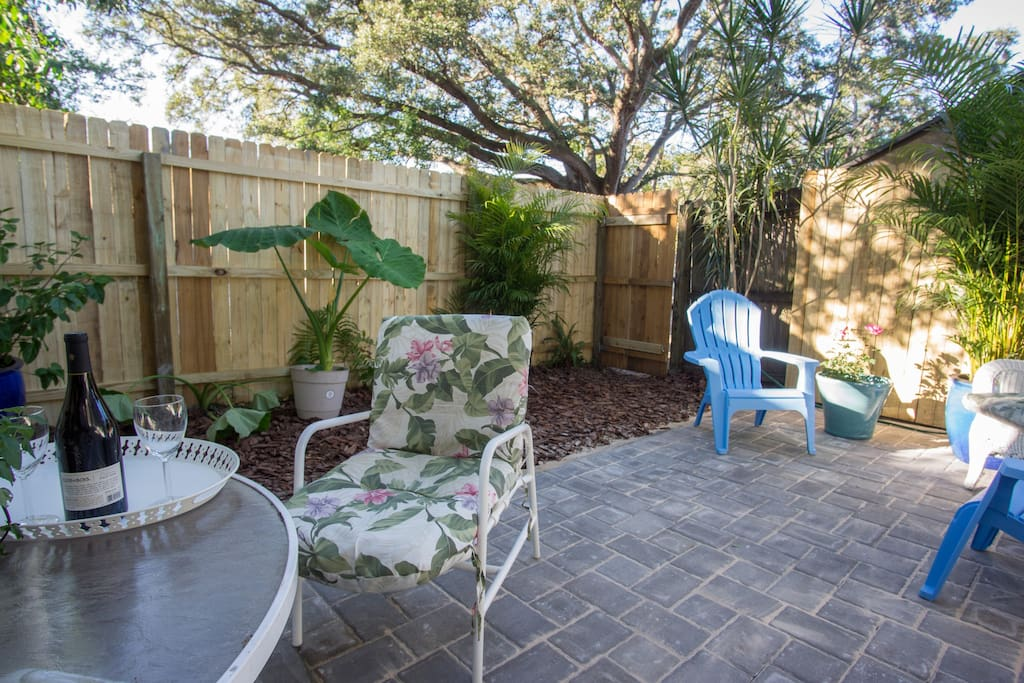 The private patio offers room for dining and relaxing in the shade of the huge old live oaks