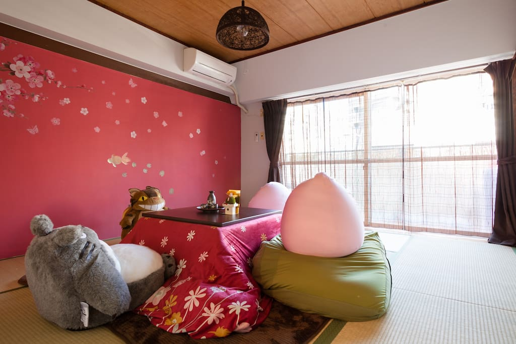 Japanese traditional tatami room with comfy beads cushions.  Relax and chat with Totoro.