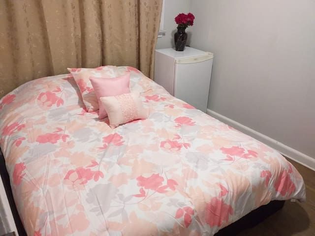 Furnished ROOM with queen bed.