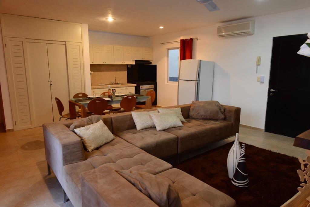 Main area with living room, dining area and kitchen