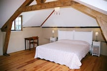 Larger bedroom on top floor with one double bed
