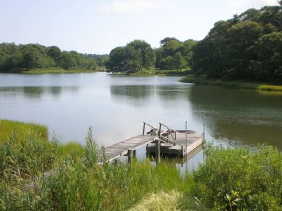 View of the dock in the salt water creek from the lawn.