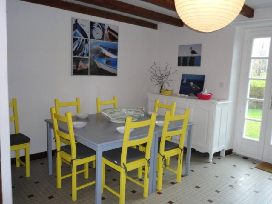 Spacious dining area with seating for eight.