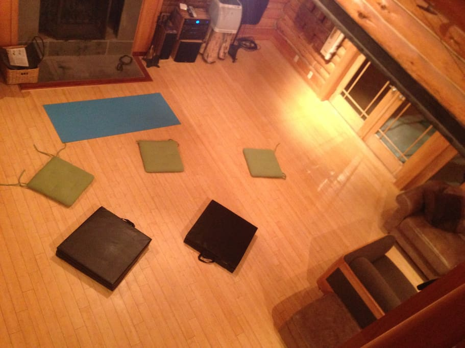 Shared living room- set up for a group yoga and meditation retreat.