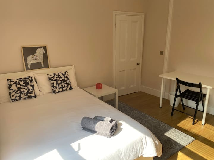 Nice private bedroom yards from station