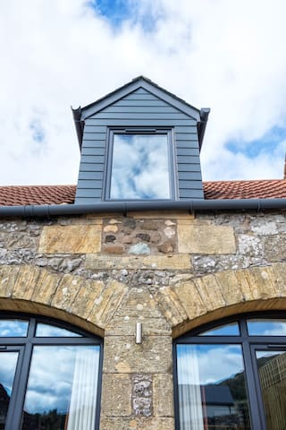 Beautiful sandstone archways with brand new grey double glazed windows throughout give the old The Arches steading a modern twist.